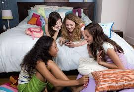 Girls talking at a slumber party